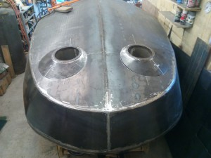 Finish fitting of turret assemblies prior to welding in place.