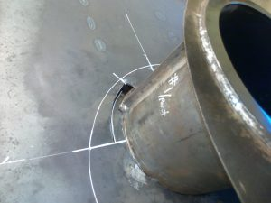 Screwing the barrels into the hull prior to welding.